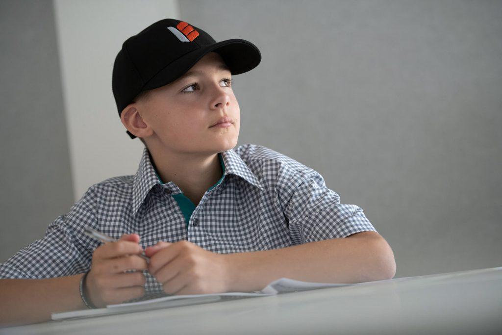 Student wearing cap